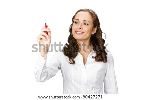Happy smiling cheerful young business woman writing or drawing on screen with red marker, isolated on white background - stock photo