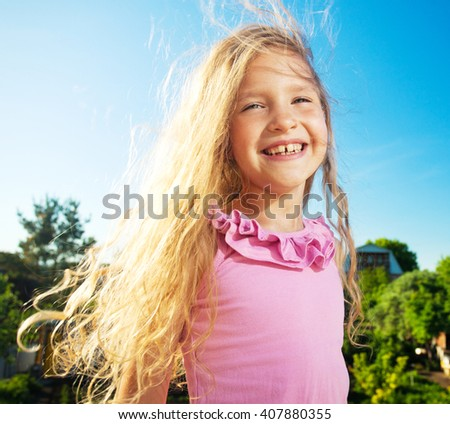 Happy smiling child at summer. Laughing girl - stock photo