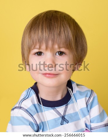 Happy smiling child, boy, looking at camera - stock photo