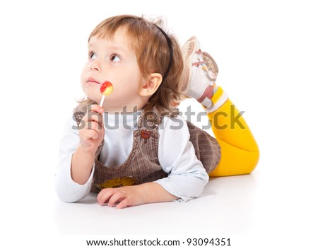 Happy smiling child with candy. Isolated on a white background