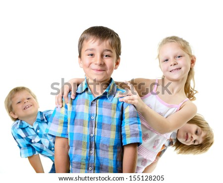 happy smiling children friends playing on a white background - stock photo