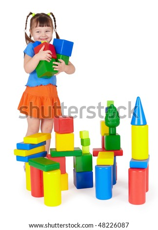 Happy smiling children playing with colorful toys on white - stock photo