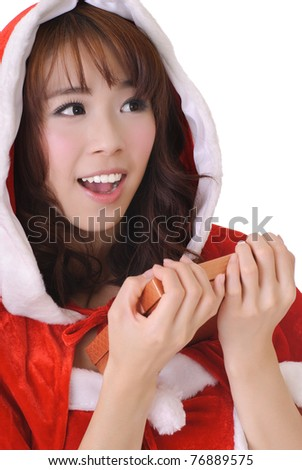 Happy smiling Christmas girl holding gift box and looking, half length closeup portrait on white background. - stock photo