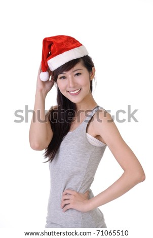 Happy smiling Christmas girl of Asian, closeup portrait against white background. - stock photo