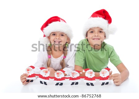 Happy smiling christmas hat kids holding paper santas