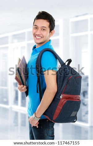 Happy smiling college student in campus - stock photo