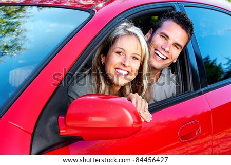 Happy smiling couple in a car. Driving. - stock photo