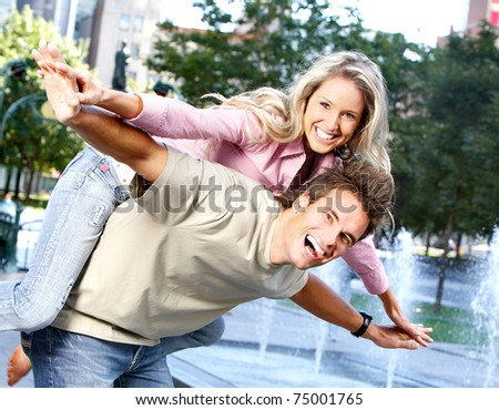 Happy smiling couple in love on the street - stock photo