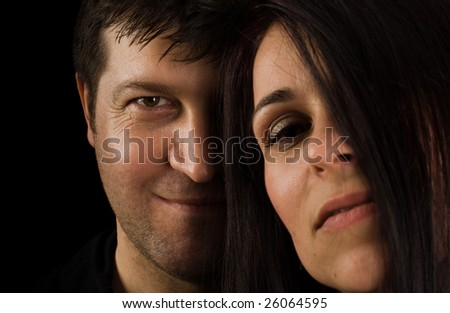 Happy smiling couple in love. Over black background - stock photo