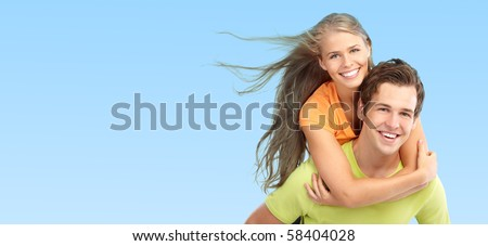 Happy smiling couple in love. Over blue background - stock photo