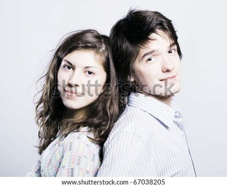 Happy smiling couple in love, over white background - stock photo