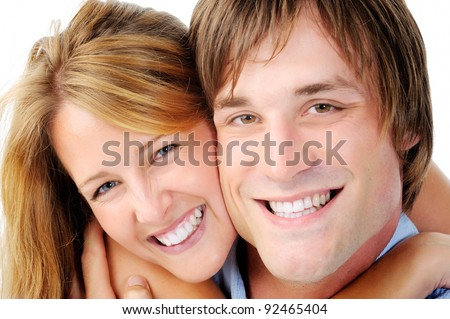 happy smiling couple portrait isolated on white