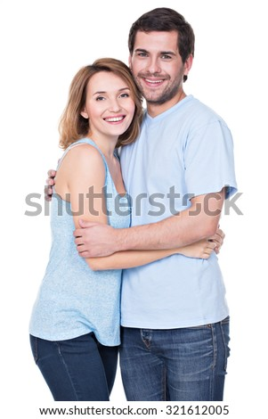 Happy smiling couple standing together looking at camera -  isolated on white background.