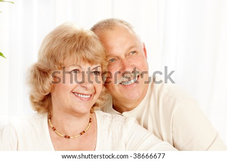 Happy smiling elderly couple at home