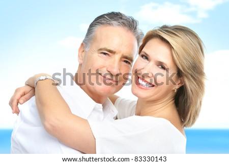 Happy smiling elderly couple. Over blue background. - stock photo