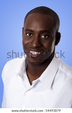 Happy smiling face of a handsome African American business man wearing a white shirt, isolated. - stock photo