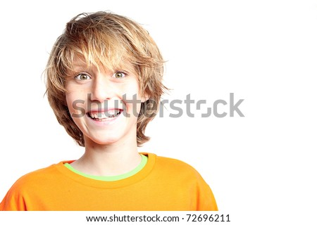 happy smiling face of ptre teen boy or kid - stock photo
