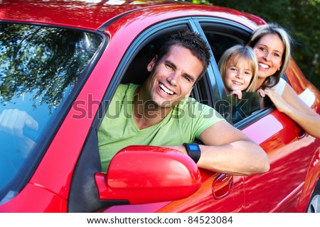 Happy smiling family and a family car. - stock photo