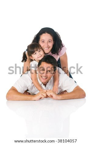 Happy smiling family lying down together isolated on white background