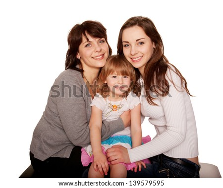 Happy smiling family, mother and two daughters, a teenager and a toddler. Isolated on white background - stock photo