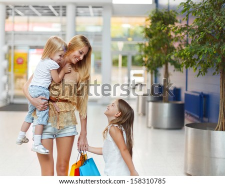 Happy smiling family on shopping in the store - stock photo