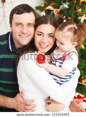Happy smiling family with near the Christmas tree - stock photo