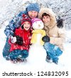Happy smiling family with snowman winter portrait - stock photo