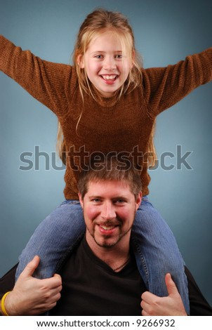 happy, smiling father and daughter playing