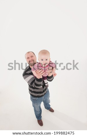 Happy smiling father lifting up a baby boy. Top view isolated portrait on the white background. Family concept. - stock photo