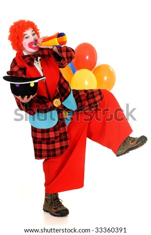 Happy smiling female clown, colorfull dressed, studio shot on white background - stock photo