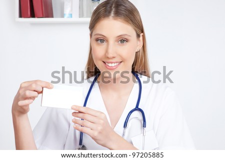 Happy smiling female doctor  holding a medicine packet. - stock photo