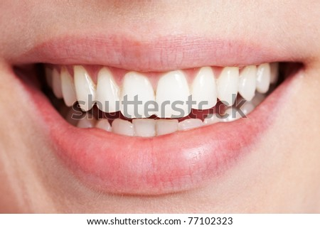 Happy smiling female mouth with white teeth - stock photo