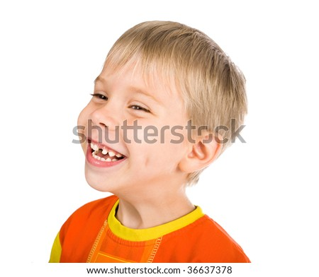 happy smiling five-year-old boy without one tooth - stock photo