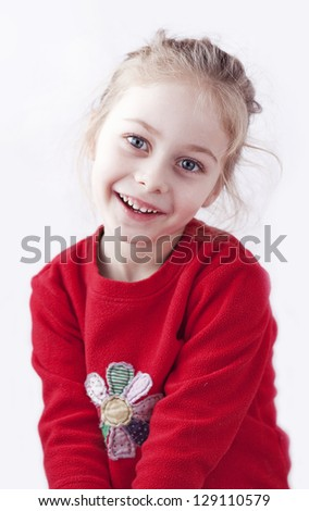 Happy smiling five years old blond child girl isolated on white looking at the camera - stock photo