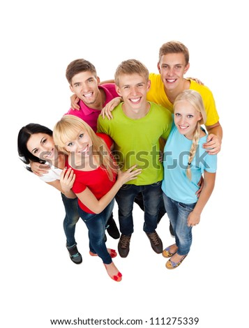 Happy smiling friends, group of young people standing and embracing together top angle view full length portrait isolated on white background - stock photo