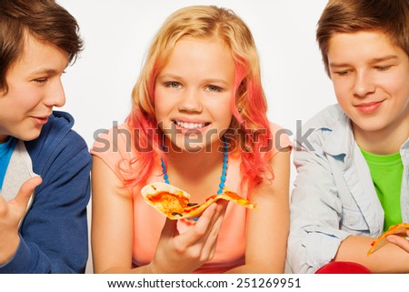 Happy smiling friends holding pizza pieces - stock photo