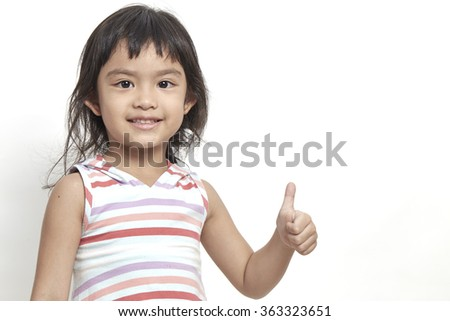 Happy smiling girl beautiful black hair showing thumbs up gesture on white background - stock photo