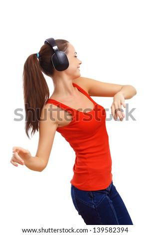 happy smiling girl dancing listening music stock photo