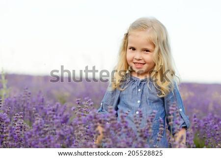 happy smiling girl in lavender field - stock photo