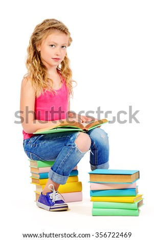 Happy smiling girl reading books. Education. Isolated over white.