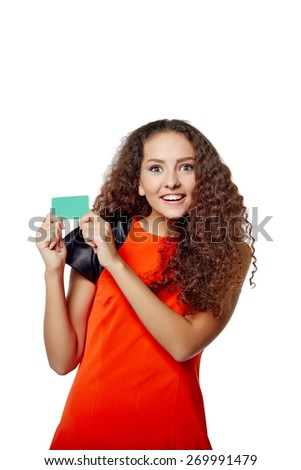 Happy smiling girl showing blank credit card, on white background - stock photo