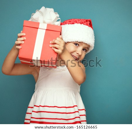 Happy  smiling girl  with  christmas gift  box. - stock photo