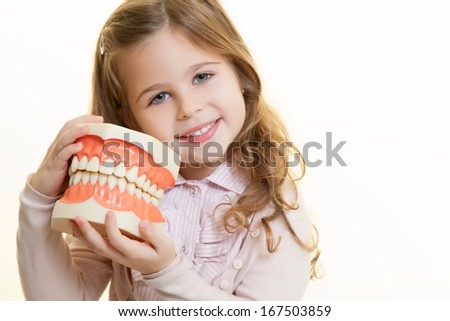 Happy smiling girl with dentist tool - stock photo