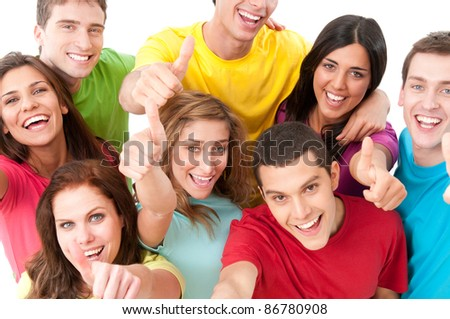 Happy smiling group of joyful friends showing thumb up isolated on white background - stock photo