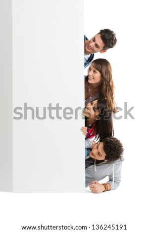 Happy Smiling Group Of Teenager Isolated Looking At Blank Placard Board - stock photo