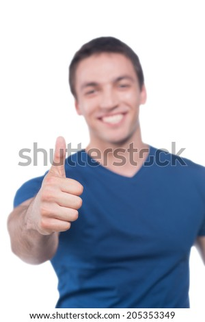 Happy smiling guy showing thumb up hand sign, isolated