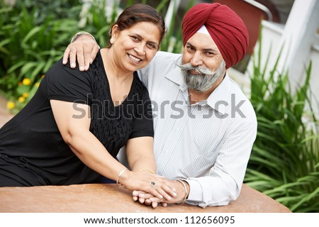 Happy Smiling indian sikh adult people couple outdoors - stock photo
