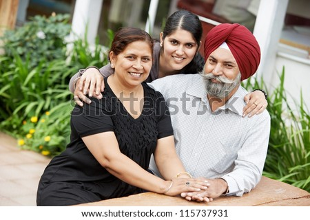 Happy Smiling indian sikh adult people family outdoors - stock photo