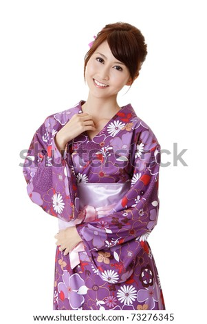Happy smiling Japanese beauty in traditional clothes, closeup portrait on white background. - stock photo