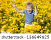 happy smiling kid jumping at the flower field - stock photo